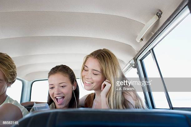 Friends listening to mp3 player in car