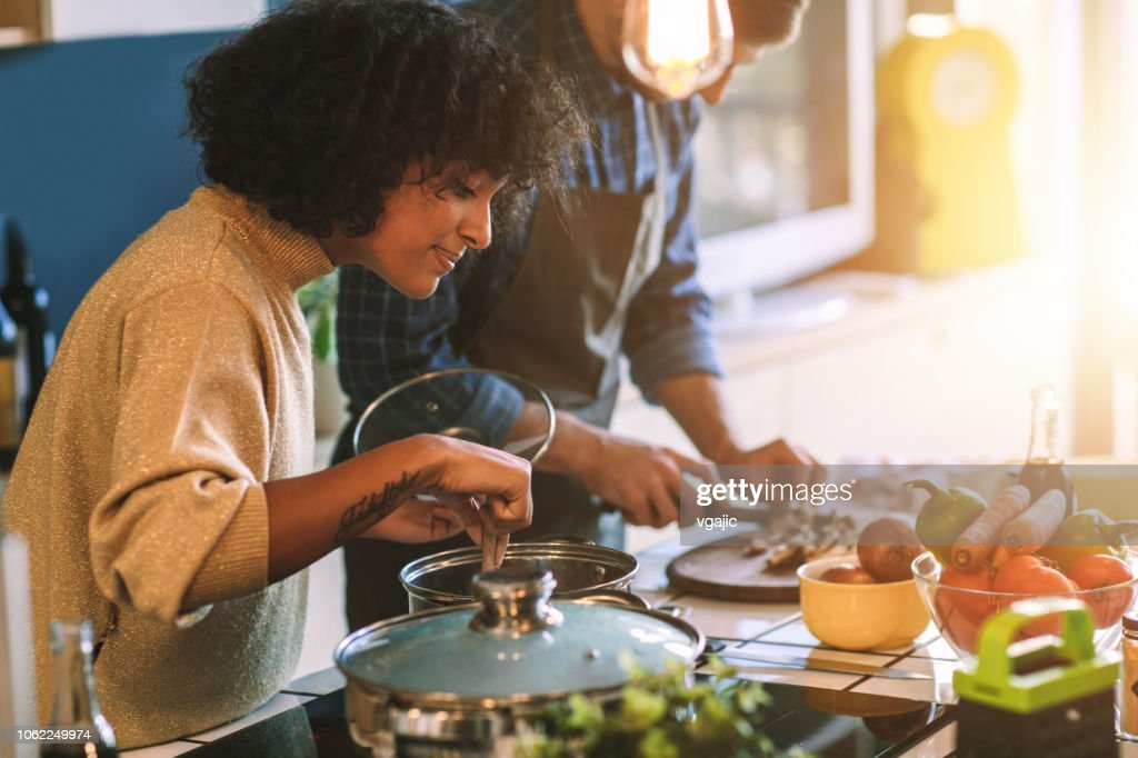 Friends Living And Cooking Together : Stock Photo