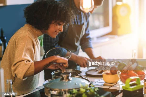 friends living and cooking together - food stock pictures, royalty-free photos & images
