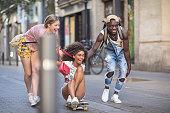 three multiethnic friends having fun with
