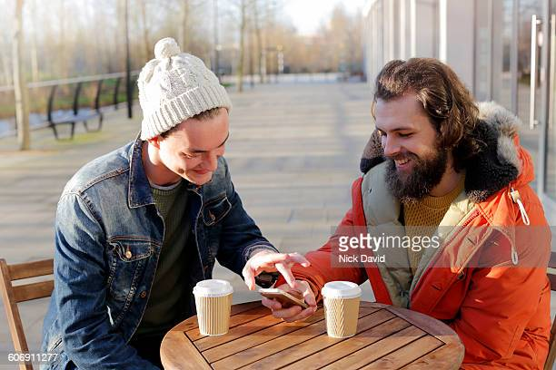 2 friends looking at a mobile phone