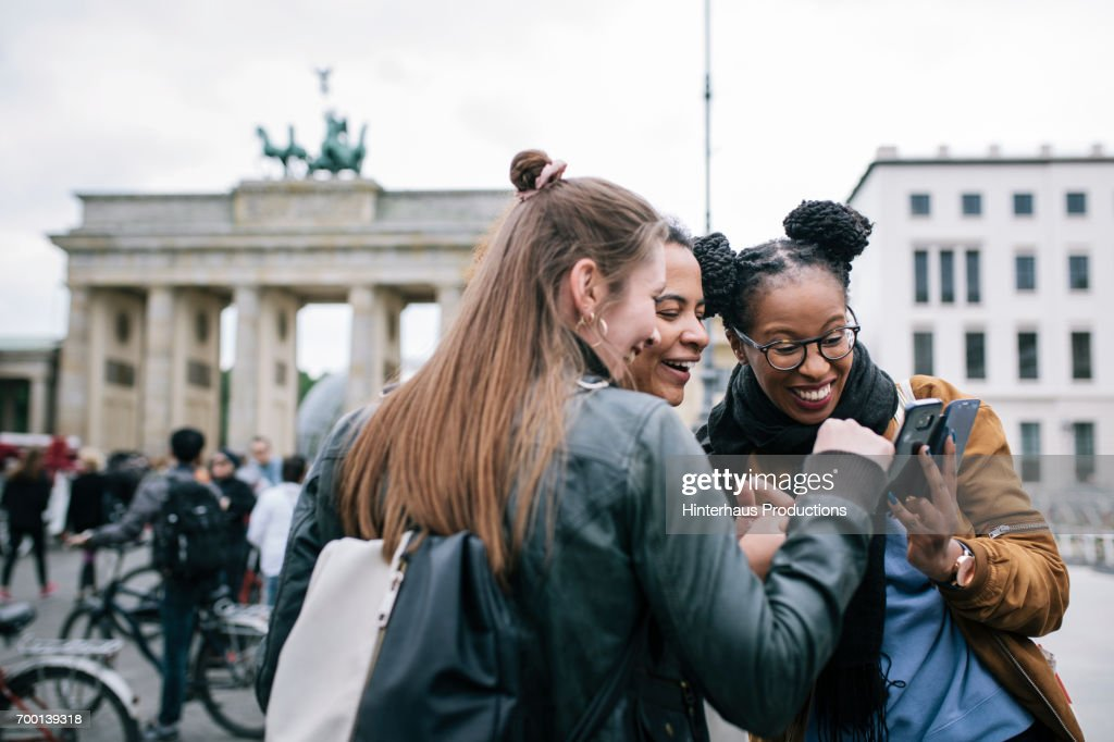Friends Looking At a Smartphone Together : Stock Photo