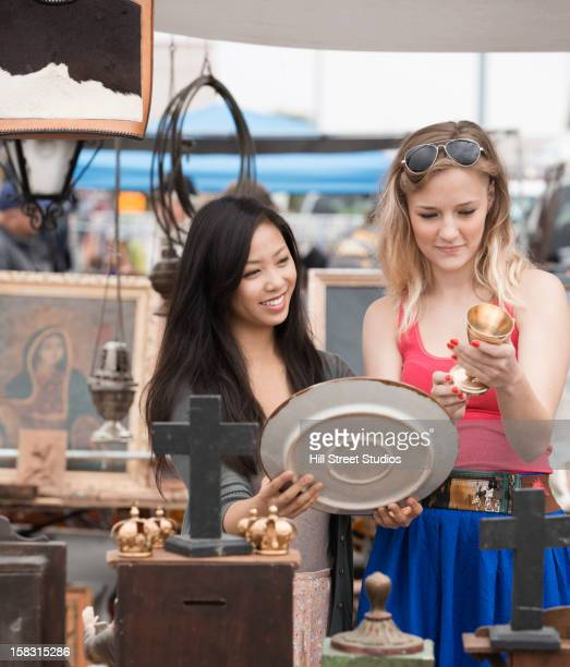Friends looking at items in flea market