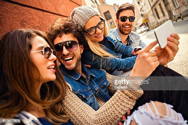 Friends looking at mobile phone