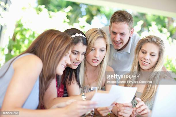 Friends looking at pictures together