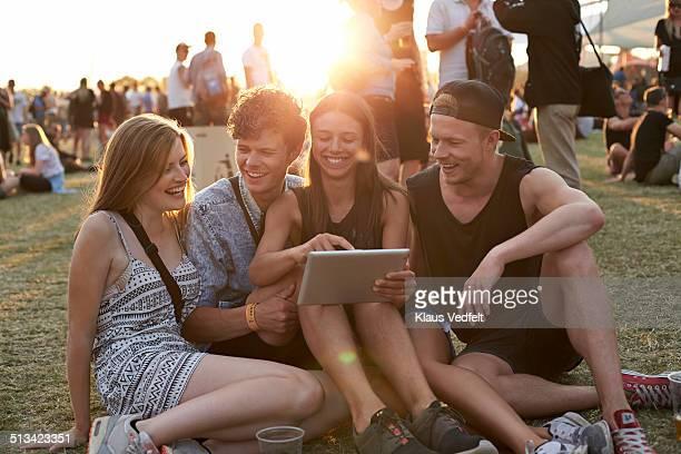 Friends looking at tablet & having fun