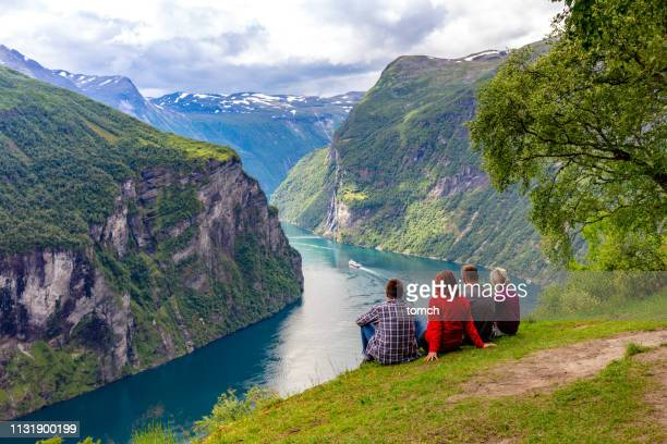 friends looking at the geirangerfjord, norway - norway stock pictures, royalty-free photos & images