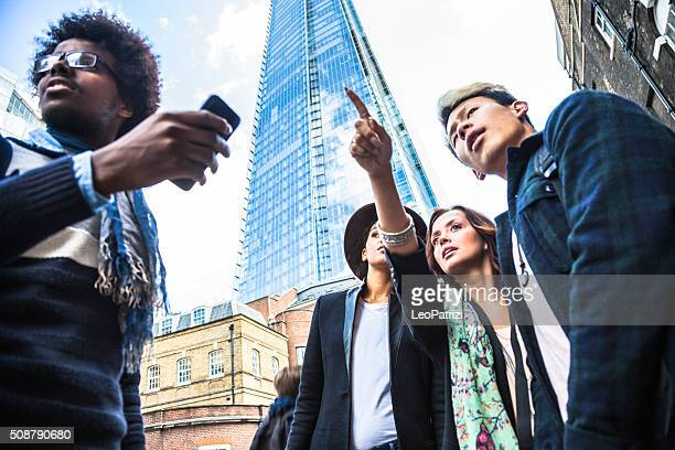 Friends looking for directions in Central London