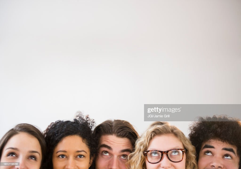 Friends looking up : Stock Photo
