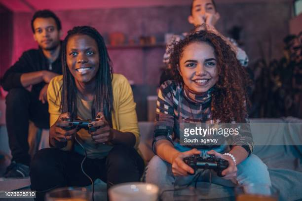 friends love video games - gamer stock pictures, royalty-free photos & images