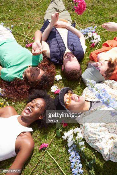 friends lying in a circle on sunny spring day - fashionable stock pictures, royalty-free photos & images
