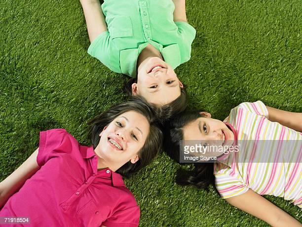 Friends lying on grass