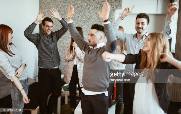 friends make a party at the office - work party stock pictures, royalty-free photos & images