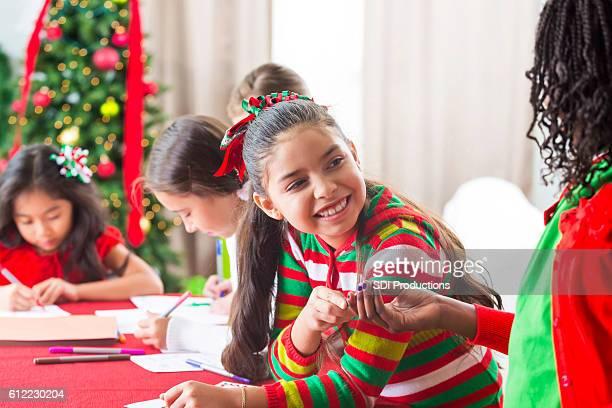 Friends make homemade Christmas crafts