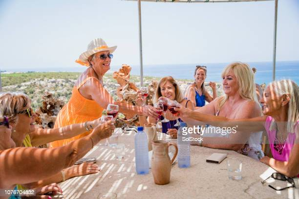 friends making a celebratory toast - early retirement stock pictures, royalty-free photos & images