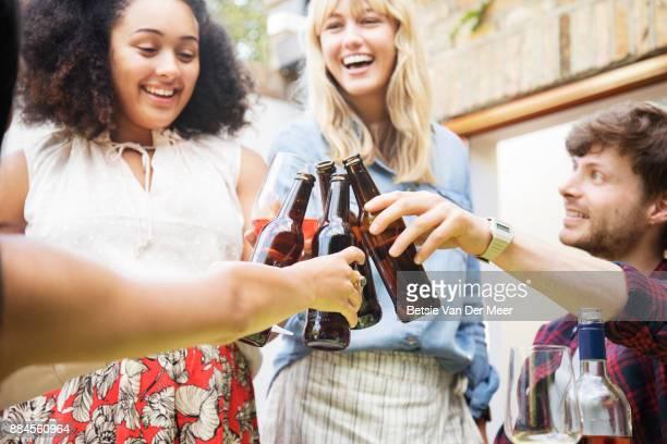 Friends making a celebratory toast.