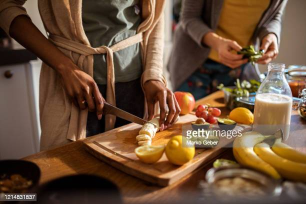 friends making a healthy meal - healthy eating stock pictures, royalty-free photos & images