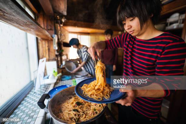 Friends making pasta in the kitchen