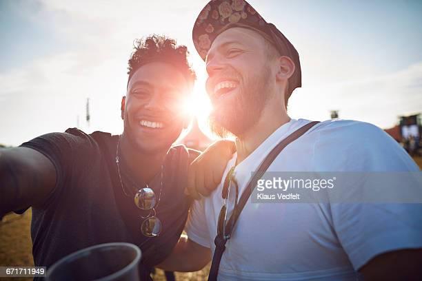 Friends making selfie at big festival concert