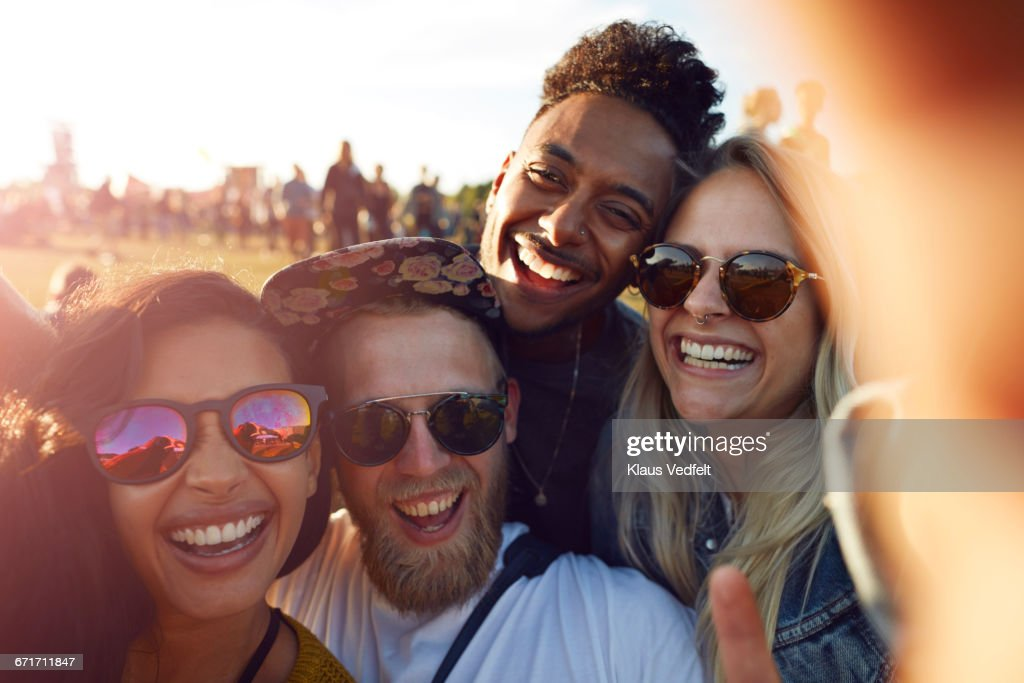 Friends making selfie at big festival : Stock Photo