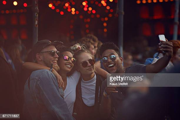 friends making selfie at concert - festival or friendship not school not business stock photos and pictures