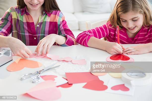 friends making valentines together - art and craft stock pictures, royalty-free photos & images
