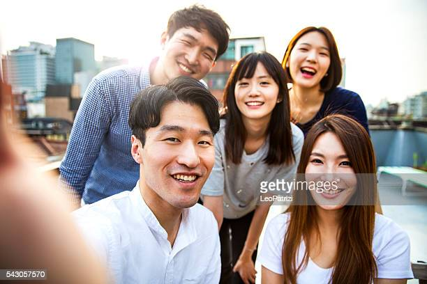 Friends meeting and party on Seoul rooftop, South Korea
