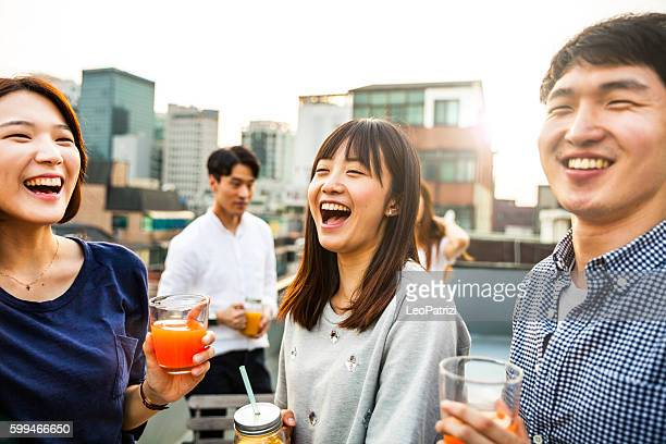 friends meeting and party on seoul rooftop, south korea - korean ethnicity stock pictures, royalty-free photos & images