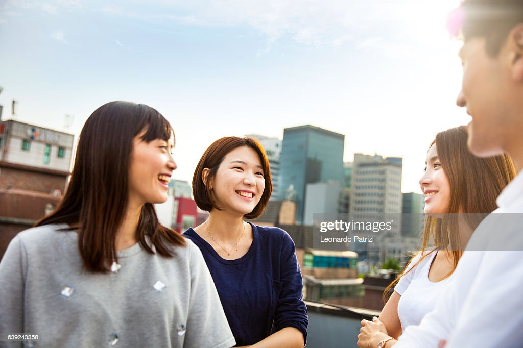 Friends meeting and party on Seoul rooftop, South Korea : Stock Photo