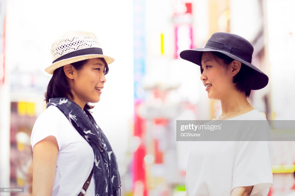 Friends meeting together to hang out at the Shibuya Ward : Stock Photo