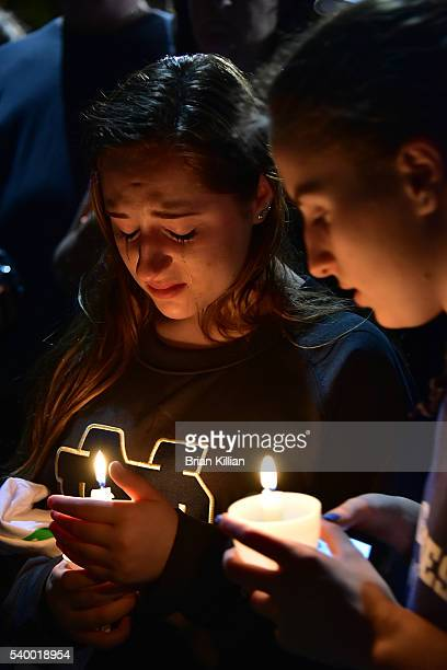 Friends mourn the loss of Christina Grimmie during the Vigil For Christina Grimmie at Evesham Memorial Complex on June 13 2016 in Evesham New Jersey