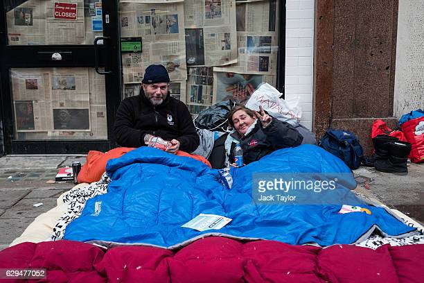 Friends Nigel and Shamrock are pictured among bedding on Charing Cross Road on December 6 2016 in London England Nigel has been homeless for 'the...