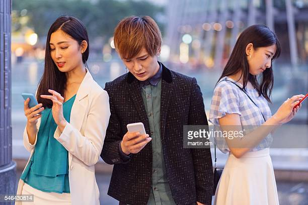 Friends obsessed by modern technologies