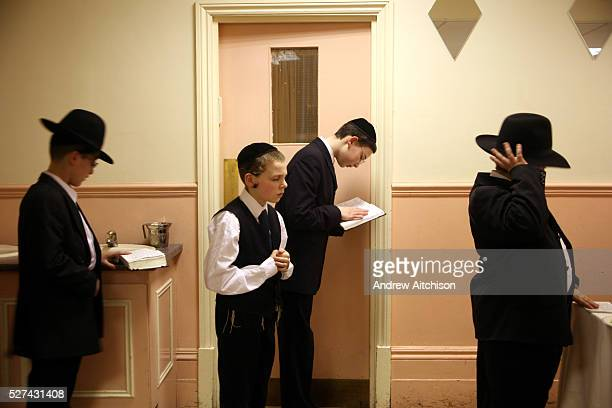 Friends of a 13 yearold Orthodox Jewish boy who have already had their Bar Mitzvah pray without him before his begins Stamford Hill The Bar Mitzvah...