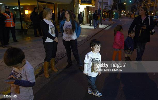 Friends of Argentine Greenpeace activist Camila wear tshirts with her portrait during a protest on September 27 2013 in front of the Russian embassy...
