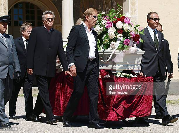 Friends of Barbara Rudnik carry the coffin during the funeral of German actress Barbara Rudnik at Nordfriedhof cemetery on May 29 2009 in Munich...