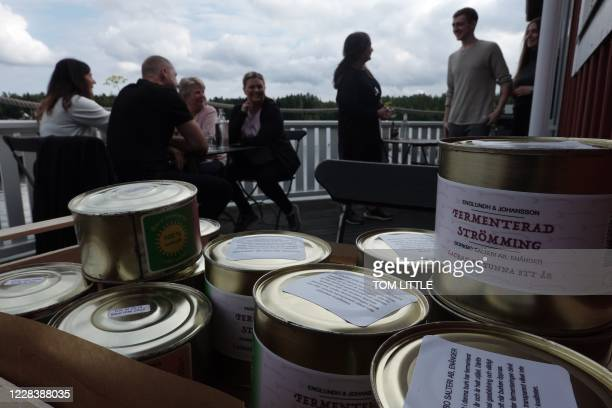 Friends of chef Malin Soderstrom arrive to eat on the terrace of her restaurant in the village of Skarsa north of Stockholm on September 4 when she...