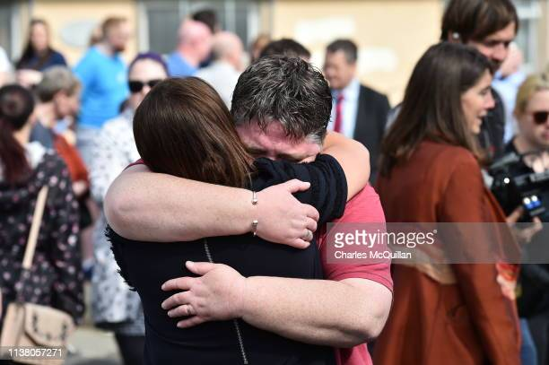 Friends of journalist and author Lyra McKee embrace as they attend a rally for her the scene of her shooting on April 19 2019 in Londonderry Northern...