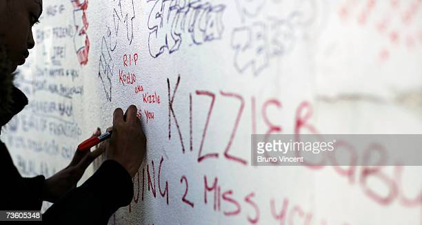 Friends of murdered teenager Kodjo Yenga write lyrical tributes on a wall near to where he was stabbed on Wednesday in Hammersmith Grove March 16...