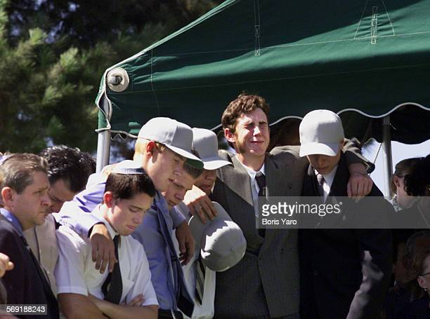 Friends of Nicholas Samuel Markowitz weep at the gravesite during services for the slain youth Most of these young men were pall bearers