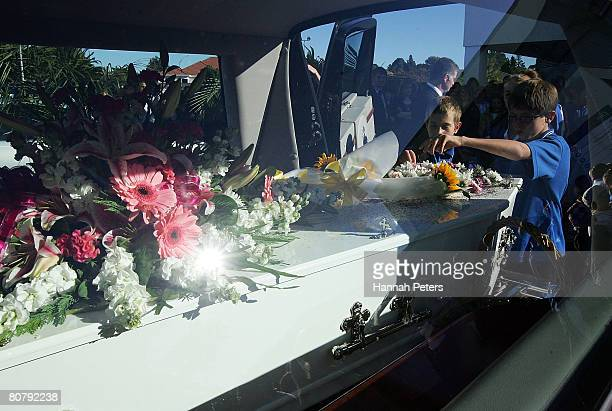 Friends of Nikki Bray scatter flower petals over her coffin after her funeral at Elim Christian College on April 21 2008 in Auckland New Zealand...