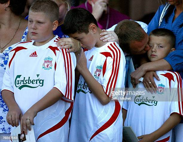 Friends of Rhys Jones stand on the steps of Liverpool Cathedral for the funeral of school boy Rhys Jones on September 6 2007 in Liverpool England 11...