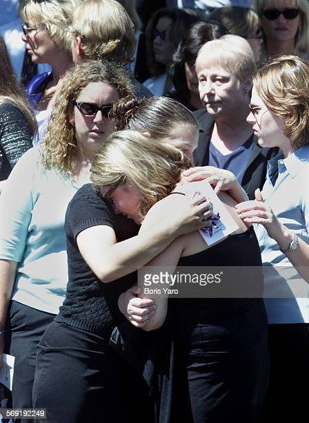 Friends of slain teenager Nicholas Samuel Markowitz console one another after memorial services for the youth