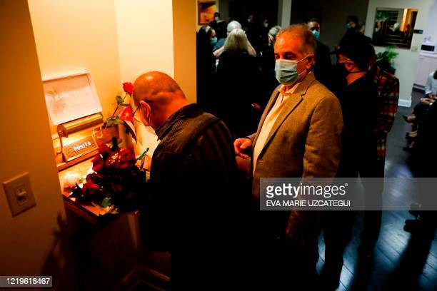 Friends of the late Cuban American singer and film actress Rosita Furnes sign a memory book for the family during the funeral at Auxiliadora Funeria...