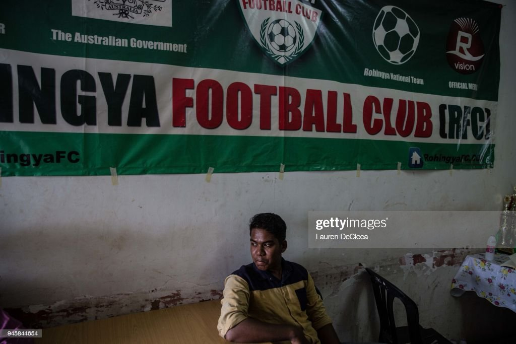 Friends of the Rohingya Football Club team members gather in the teams clubhouse on April 8, 2018 in KUALA LUMPUR, Malaysia. A group of Rohingya refugees from Myanmar's Rakhine State formed the Rohingya Football Club in Malaysia back in 2015, hoping to give the Rohingya people a voice through sports and raise their international profile amidst the crisis in the region. Rohingya Muslims are reportedly playing in Football Clubs around the world, including Canada, Australia, and Ireland, while the Rohingya F.C. aims to set up a national team which comprises of these players and show that Rakhine Muslims can succeed in the sport. The United Nations estimate that over 62 thousand Rohingya are currently living in Malaysia and most of them are only able to find jobs as a construction worker or laborer with many staying in makeshift homes near construction sites. Malaysia launched its first Rohingya tournament this year with 24 independent football clubs competing across the Muslim country, hoping to gather support from the Malaysian and Turkish governments to help them succeed at an international level. Over 700,000 Muslim Rohingya have crossed the border into Bangladesh since August last year after the Myanmar military launched a brutal crackdown which was described by the United Nations as 'ethnic cleansing' while the two countries continue to negotiate the repatriation of the Rohingya refugees.