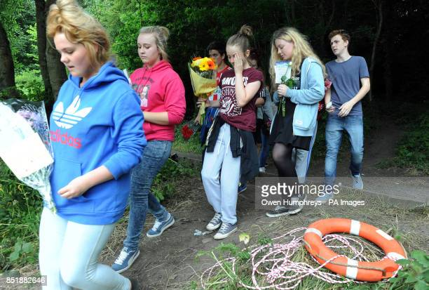 Friends of the two teenagers who drowned throw flowers in the river where Tonibeth Purvis from Barmston Washington Tyne and Wear and Chloe Fowler...