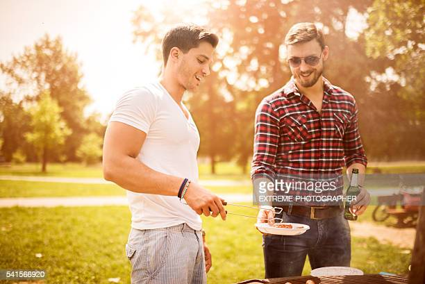 Friends on a barbecue picnic
