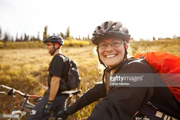 friends on a bike ride in the backcountry. - sports helmet stock pictures, royalty-free photos & images