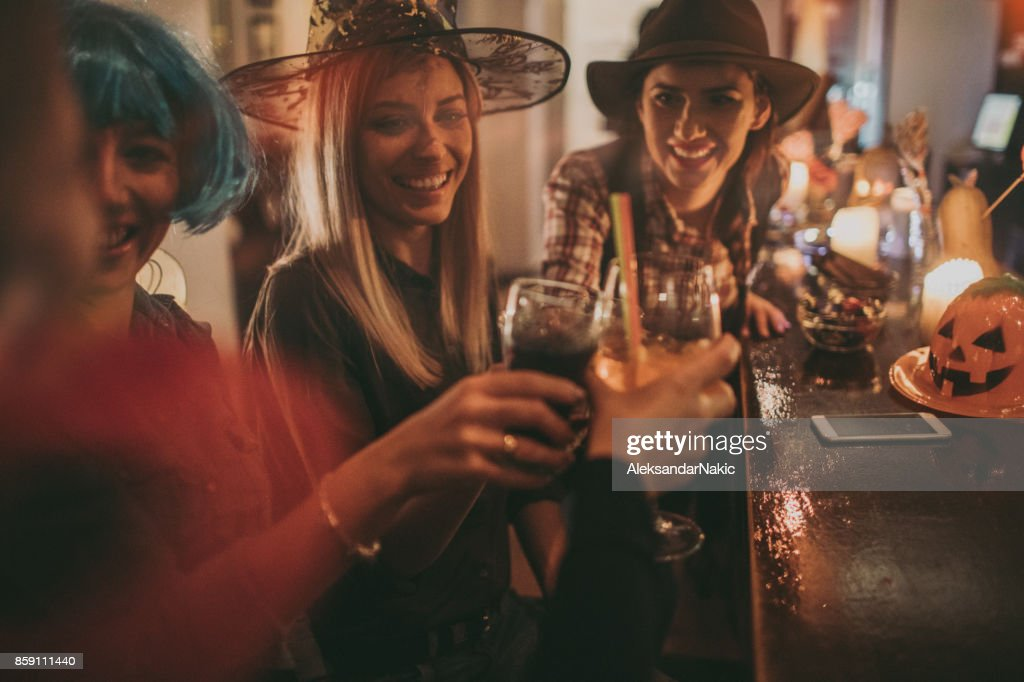 Friends on a Halloween party : Stock Photo