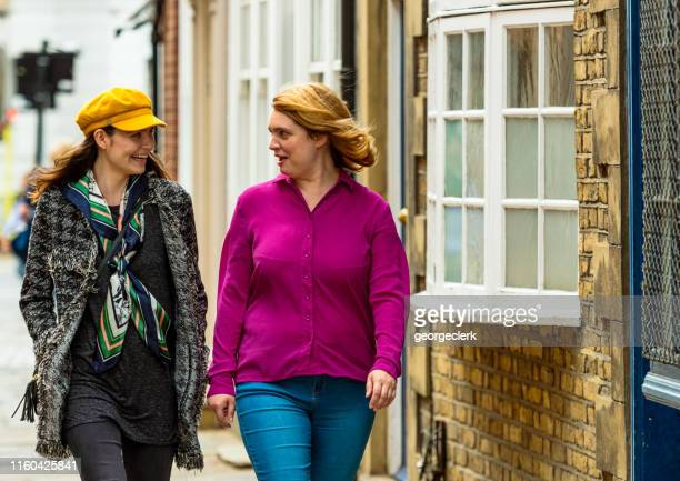 friends on a london street - greenwich london stock pictures, royalty-free photos & images